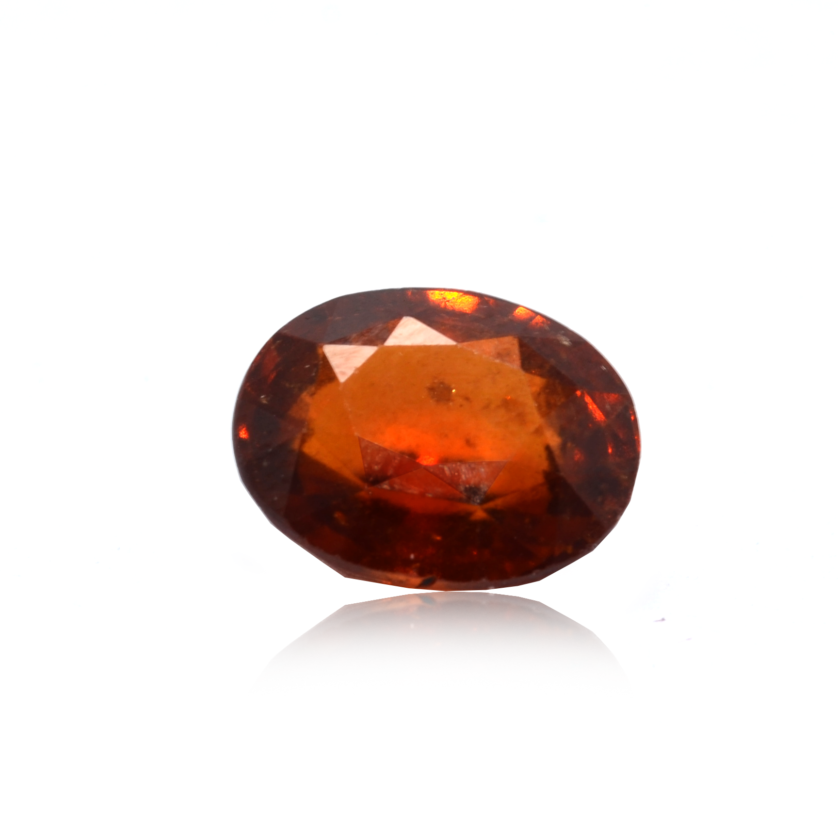 6.90 CARAT, OVAL MIXED CUT NATURAL HESSONITE GARNET